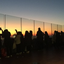 The crowd gathering at sunset at The Top of the Rock