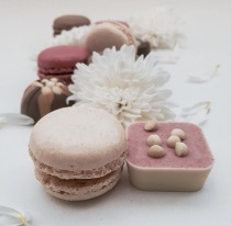 Chocolate, flowers and macaron flat lay