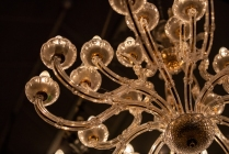 The gorgeous chandelier hanging from the ceiling